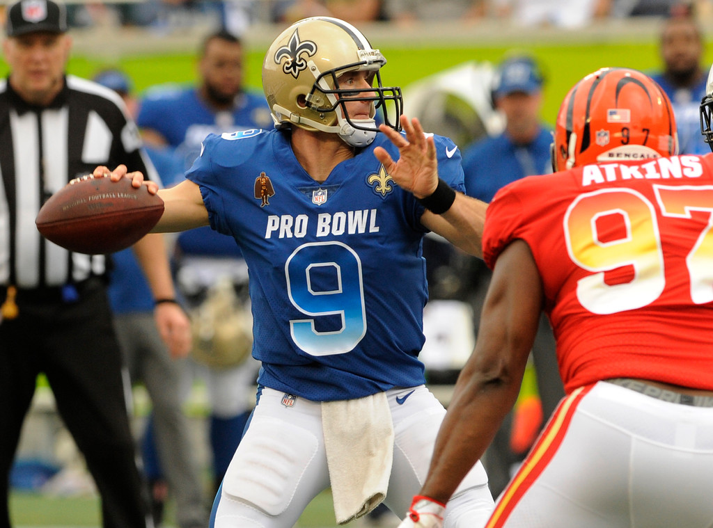 . NFC quarterback Drew Brees (9), of the New Orleans Saints, looks to pass under pressure from AFC defensive tackle Geno Atkins (97) of the Cincinnati Bengals, during the first half of the NFL Pro Bowl football game, Sunday, Jan. 28, 2018, in Orlando, Fla. (AP Photo/Steve Nesius)