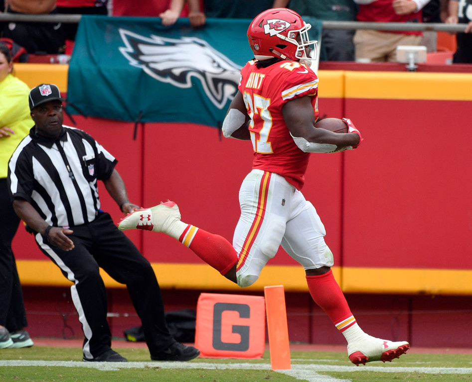 . Kansas City Chiefs running back Kareem Hunt (27) runs for a 53-yard touchdown, during the second half of an NFL football game in Kansas City, Mo., Sunday, Sept. 17, 2017. (AP Photo/Ed Zurga)