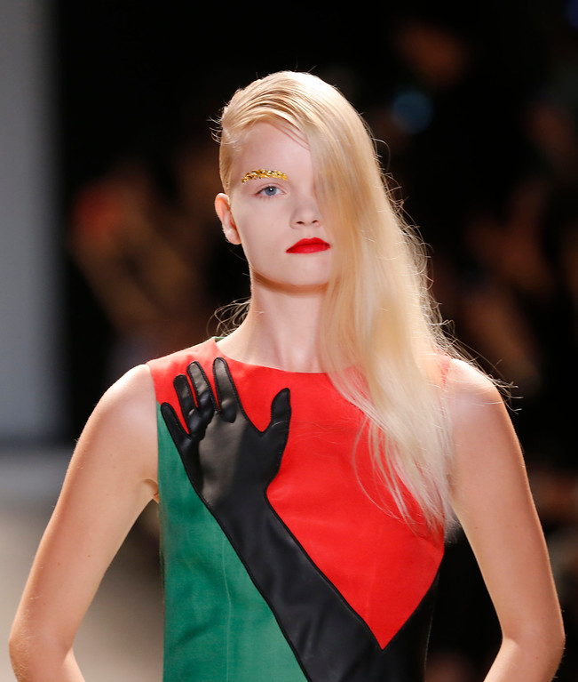 . A model wears a creation for Jean-Charles de Castelbajac\'s ready-to-wear Spring/Summer 2014 fashion collection, presented in Paris, Tuesday, Oct.1, 2013. (AP Photo/Jacques Brinon)