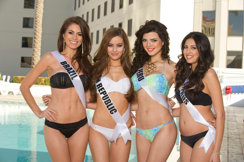 . (L-R)Miss Universe 2012 contestants Miss Brazil Gabriela Markus, Miss Czech Republic Tereza Chlebovska and Miss Peru Nicole Faveron and Miss Cyprus Ioanna Yiannakou pose for photos in their swimwear at Planet Hollywood Resort and Casino, in Las Vegas, Nevada December 3, 2012. The Miss Universe 2012 competition will be held on December 19. REUTERS/Darren Decker/Miss Universe Organization L.P/Handout