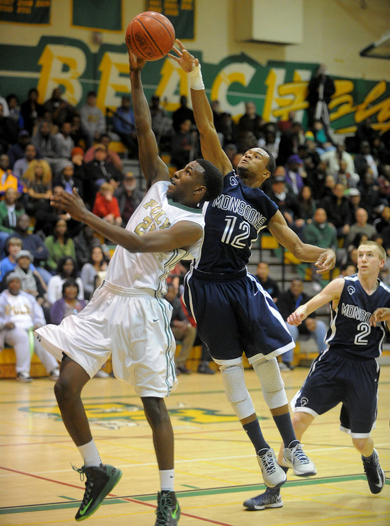. 02-19-2012--(LANG Staff Photo by Sean Hiller)- Mayfair at Poly in the second round of the Division I-AA boys basketball playoffs Tuesday night. Mayfair\'s Jarrod Sheffield blocks Poly\'s Brandon Staton from scoring.
