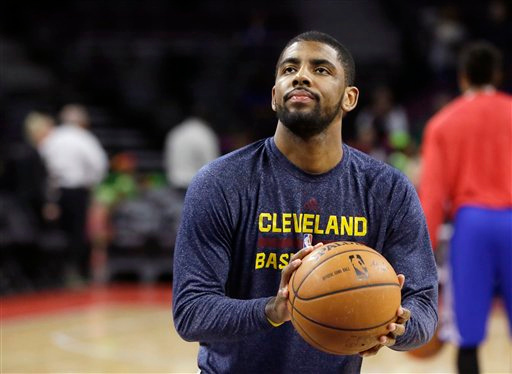 . Cleveland Cavaliers guard Kyrie Irving shoots free throws before an NBA basketball game against the Detroit Pistons, Tuesday, Feb. 24, 2015 in Auburn Hills, Mich. (AP Photo/Carlos Osorio)