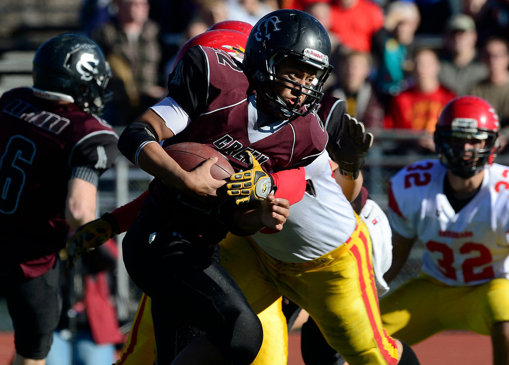 . Silver Creek\'s Josh Quiroz carries the ball in the first quarter against Coronado during the Class 3A state championship game Saturday Nov. 30, 2013 at Everly-Montgomery Field.  (Lewis Geyer/Times-Call)