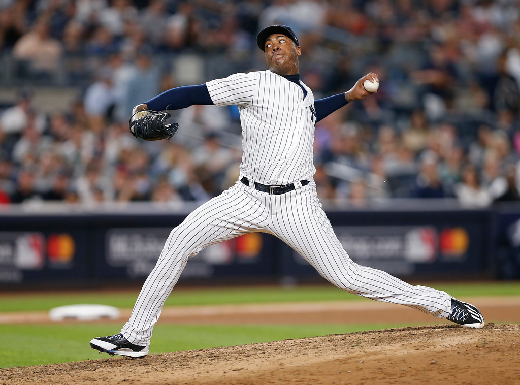. New York Yankees pitcher Aroldis Chapman delivers against the Cleveland Indians during the eighth inning in Game 3 of baseball\'s American League Division Series, Sunday, Oct. 8, 2017, in New York. (AP Photo/Kathy Willens)