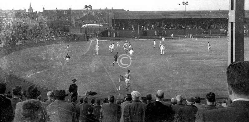Cathkin Park, an early-season midweek match, some time between the installation of floodlights in the autumn of 1959 and the building of the new stand in the summer of 1962. Best guess is a League Cup sectional match, Third Lanark 3 Airdrie 1, in August 1961.  Joe McInnes has sent over a  high corner which Jim Goodfellow is aiming to meet, while Dave Hilley and Matt Gray are looking for a nod back. Alex Harley is poised to make a run, while Willie Cunningham looks on from outside the box. Sorry, can't name any of the Airdrie players.  I must have watched Thirds at Cathkin over a hundred times between around 1956 and the liquidation in 1967 (my mother's family were dyed-in-the-wool Hi-Hi, Cathkin was 5 minutes' walk up Cathcart Road, and in the later years I would carefully save up the 10/- required to purchase a schoolboy season ticket in early August), but this is the only photo I took there, or at least the only one that has survived. The negative is in very poor condition.