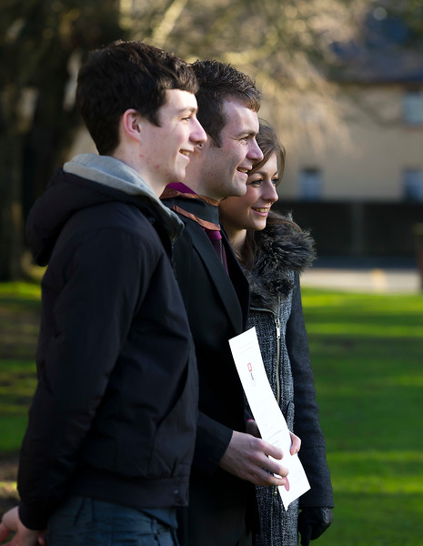 06/01/2015. FREE TO USE IMAGE. WIT (Waterford Institute of Technology) Conferring, Pictured in center is Tom Dunne, Kilmuckridge, Co. Wexford who Graduated Bachelor of Arts (Hons) in Exercise and Health, also pictured is his brother Robbie and sister Laura. Picture: Patrick Browne
