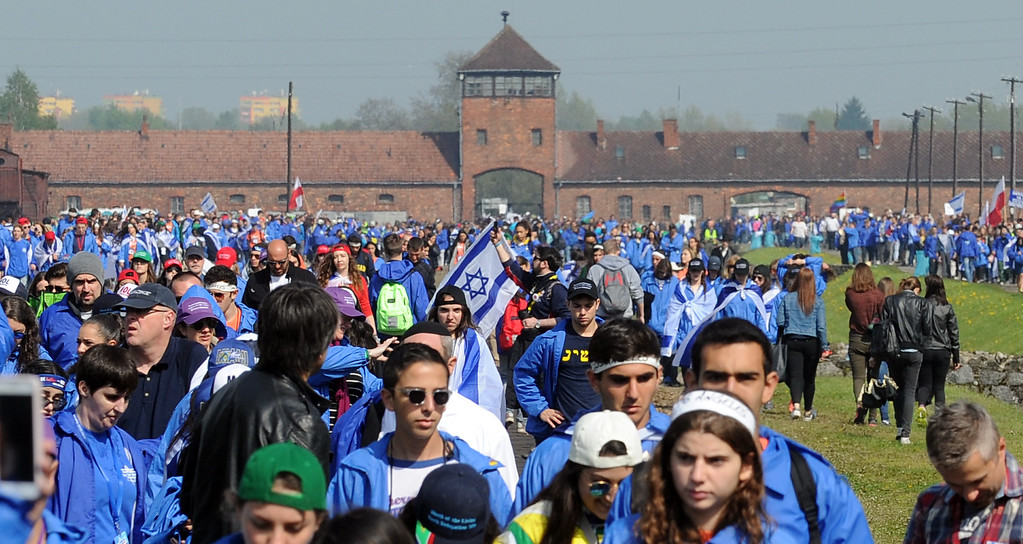 . Participants of the yearly March of the Living walk in the former German Nazi Death Camp Auschwitz-Birkenau, in Brzezinka, Poland, Thursday, May 5, 2016. Thousands of people from around the world have paid homage to the victims of the Holocaust with a somber march from the barracks of Auschwitz to nearby Birkenau. (AP Photo/Alik Keplicz)