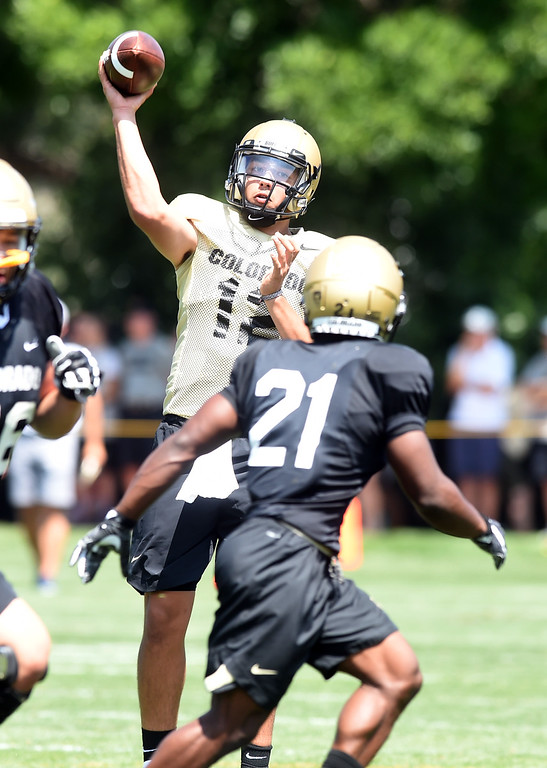 . CU QB, Steven Montez, throws to Kyle Evans at practice during CU football and Fall sports media day. For more photos, go to dailycamera.com. Cliff Grassmick  Staff Photographer  August 4, 2018