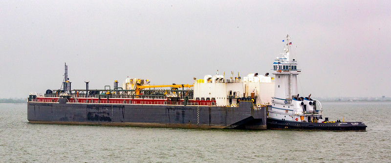 A large tanker barge and push boat