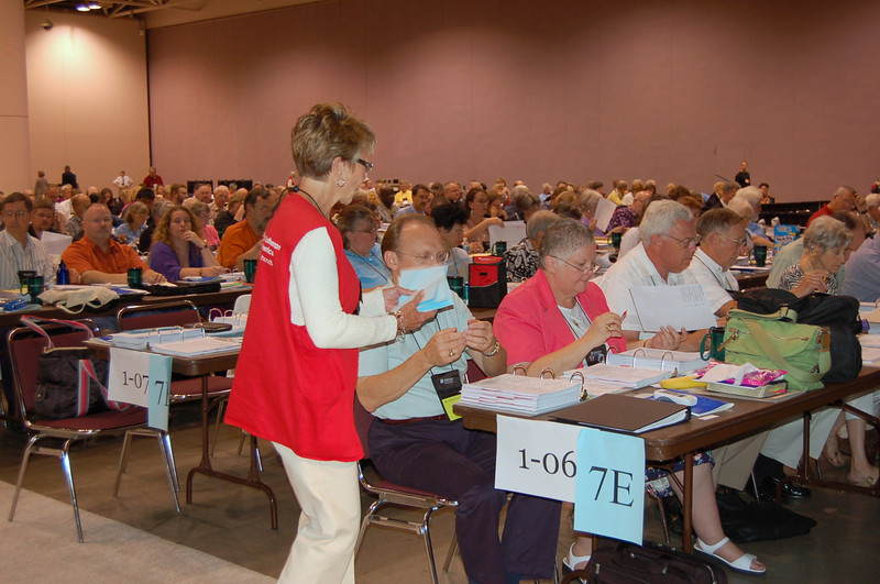 A volunteer gathers the ballots from the Northeastern Pennsylvania Synod.