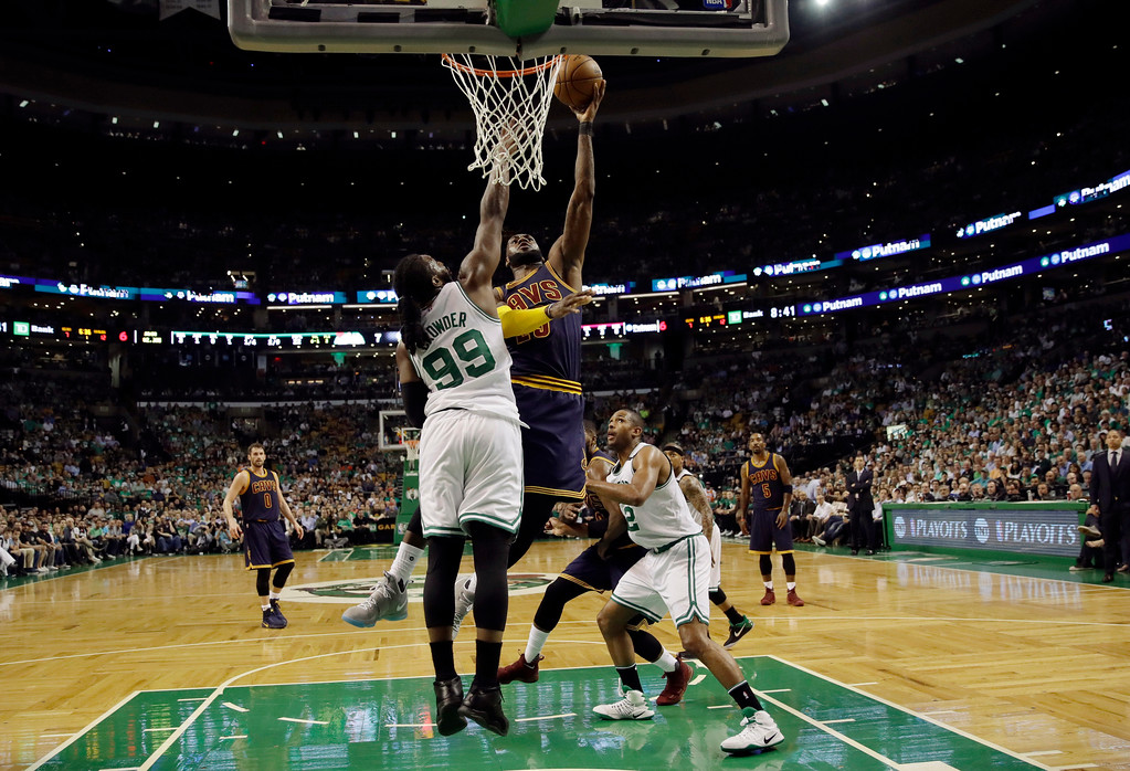 . Cleveland Cavaliers forward LeBron James drives against Boston Celtics forward Jae Crowder (99) during the first quarter of Game 1 of the NBA basketball Eastern Conference finals, Wednesday, May 17, 2017, in Boston. (AP Photo/Charles Krupa)