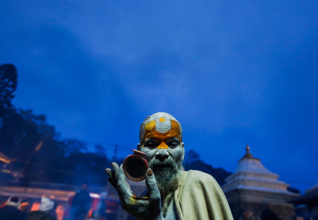 . A Sadhu (holy man) paints his face at the Pashupati Temple in Kathmandu, Nepal, 27 February 2014, to mark the biggest Hindu festival Maha Shivaratri. More than 100,000 Hindu devotees including Sadhus from across the country and neighboring India are worshipping at the Pashupati temple to celebrate the birthday of Lord Shiva, the god of creation and destruction. Hindus mark the Maha Shivratri festival by offering special prayers and fasting.  EPA/NARENDRA SHRESTHA