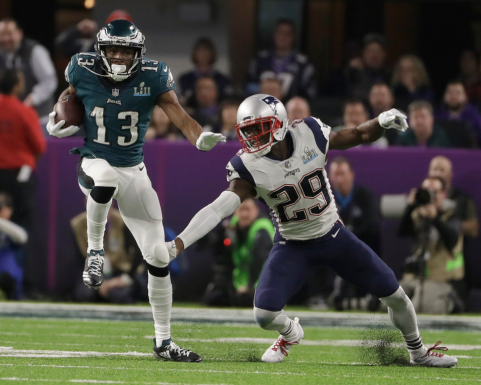 . Philadelphia Eagles\' Nelson Agholor (13) runs past New England Patriots\' Johnson Bademosi after a catch during the second half of the NFL Super Bowl 52 football game Sunday, Feb. 4, 2018, in Minneapolis. (AP Photo/Matt Slocum)