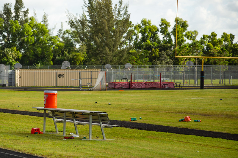 Discarded drink bottles, shoes and other assorted football related items litter the field at Palm Beach Central High School after a shooting during a football game on Friday night. Image captured on Saturday, August 18, 2018. (Joseph Forzano / The Palm Beach Post)