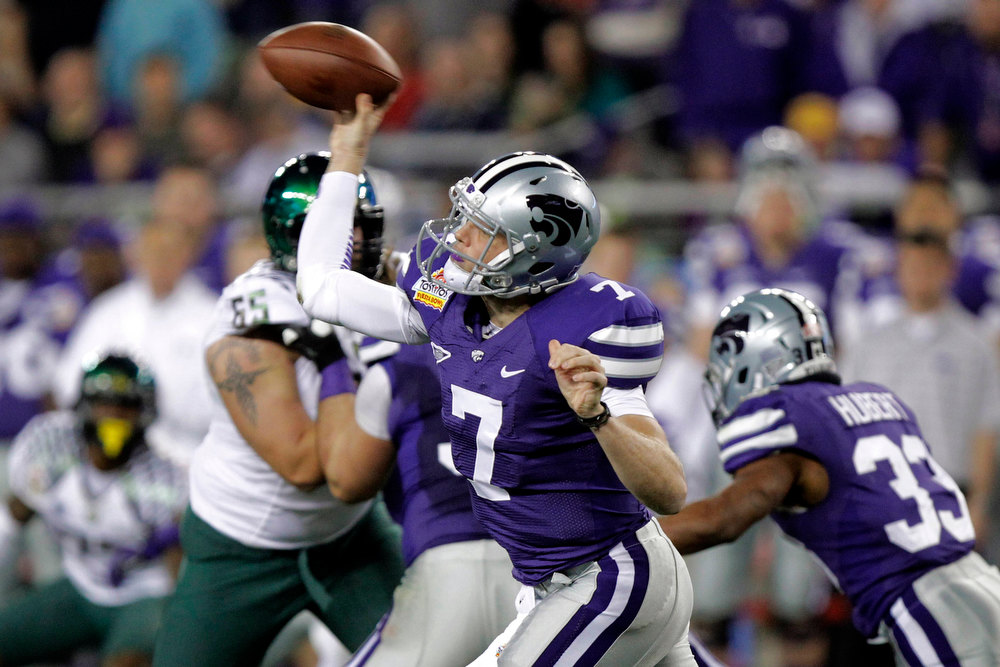 . Kansas State quarterback Collin Klein (7) throws against Oregon during the first half of the Fiesta Bowl NCAA college football game, Thursday, Jan. 3, 2013, in Glendale, Ariz. (AP Photo/Paul Connors)