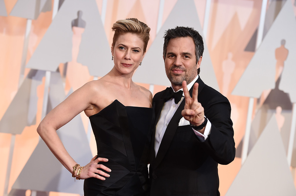 . Sunrise Coigney, left, and Mark Ruffalo arrive at the Oscars on Sunday, Feb. 22, 2015, at the Dolby Theatre in Los Angeles. (Photo by Jordan Strauss/Invision/AP)