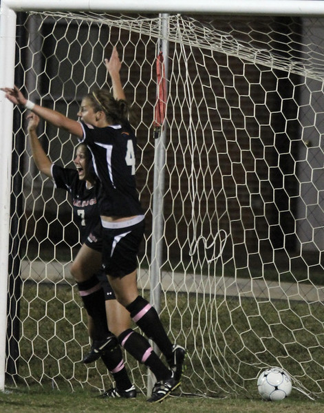 Megan Reimer, 4, and Dawn Rollyson, 7, celebrate after scoring a goal and bringing the game to a 2-2 tie against High Point.