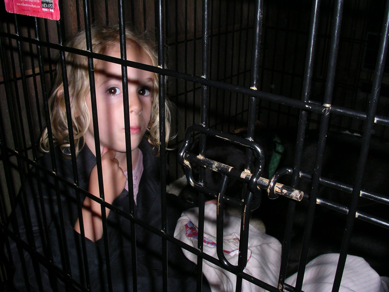 We didn't keep her locked up, I swear! :)    Playing doggie in Rocky's house.