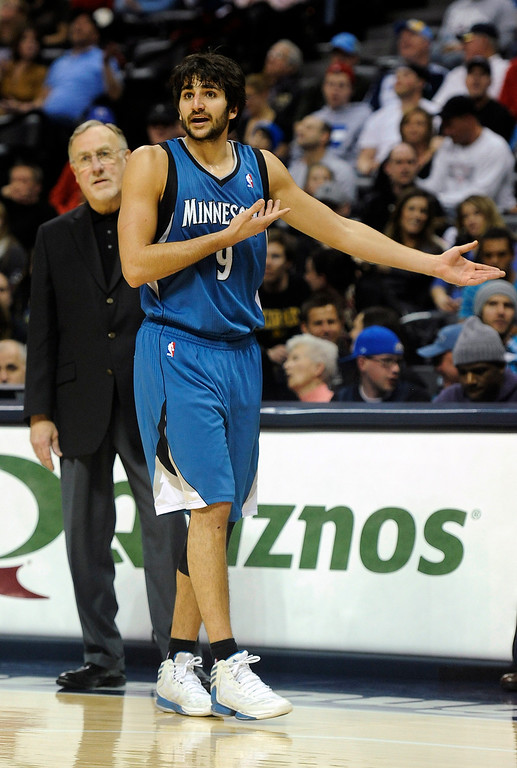 . Minnesota Timberwolves guard Ricky Rubio complains about a technical foul call in the second half of an NBA basketball game against the Denver Nuggets on Saturday, March 9, 2013, in Denver. Minnesota Timberwolves head coach Rick Adelman is at left.  (AP Photo/Chris Schneider)