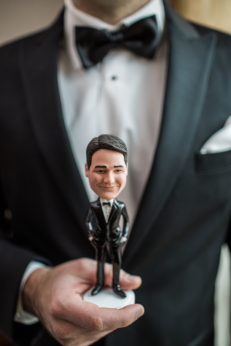 Kyle gifted his groomsmen custom bobbleheads as his groomsmen gift for his Bluemont Vineyard wedding. Photos by the best Washington DC wedding photographer Jalapeno Photography. The Catholic wedding ceremony was at St. Theresa Catholic Church in Ashburn, VA.