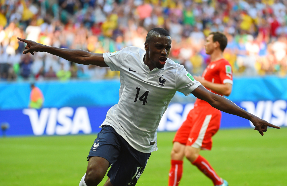. France\'s midfielder Blaise Matuidi celebrates after scoring during a Group E football match between Switzerland and France at the Fonte Nova Arena in Salvador during the 2014 FIFA World Cup on June 20, 2014.  (ANNE-CHRISTINE POUJOULAT/AFP/Getty Images)