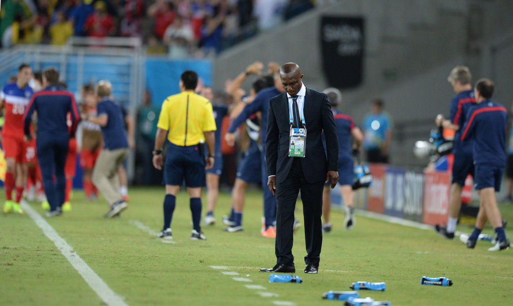 Description of . Ghana's coach Kwesi Appiah reacts after a Group G football match between Ghana and US at the Dunas Arena in Natal during the 2014 FIFA World Cup on June 16, 2014.  AFP PHOTO / CARL DE SOUZACARL DE SOUZA/AFP/Getty Images