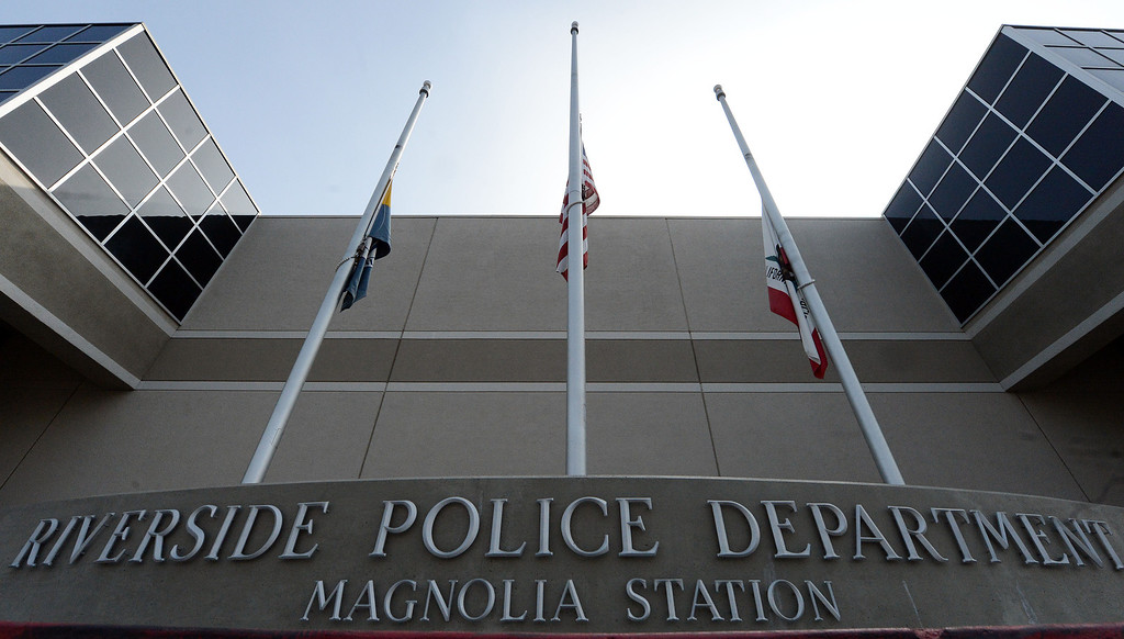 . Flags fly at half staff outside the Riverside police station Thursday February 7, 2013. Two Riverside police officers were shot early Thursday morning, one fatally, with the second in critical condition, both were believed to have been shot in a ambush by ex LAPD officer Christopher Jordan Dorner who is still at large. Dorner is also the suspect in the murder of an Irvine couple on Sunday. (Staff photo by Will Lester/Inland Valley Daily Bulletin)