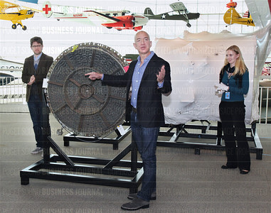 Amazon chief executive officer Jeff Bezos unveils components of the F-1 rocket engine from the Saturn V rocket that propelled the 1969 Apollo 12 launch after the parts were recently recovered from the bottom of the Atlantic Ocean
