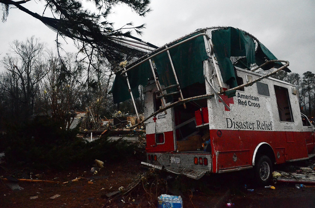 . A trampoline rests on top of a damaged American Red Cross disaster relief truck outside of the Hattiesburg American Red Cross center which was completely destroyed by an apparent tornado that moved through Hattiesburg, Miss., Sunday, Feb. 10, 2013. (AP Photo/The Hattiesburg American, Bryant Hawkins)