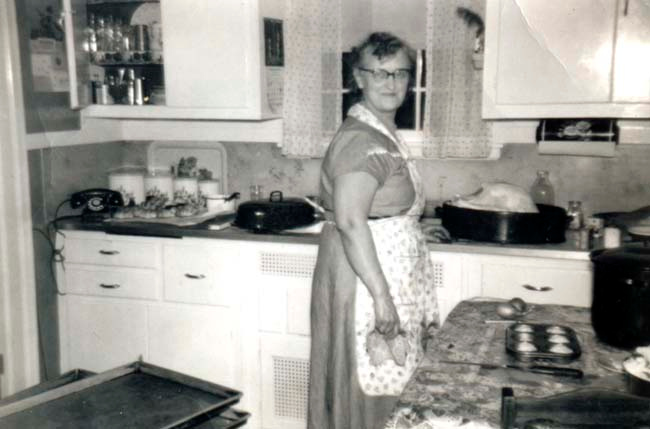 "Description of . JOAN ANDERSON AND BRUCE HALL: ""This is Annie Hall of South St. Paul, preparing her delicious Thanksgiving dinner in the early 1950s. She loved to cook and entertain. Her memorable meals were always tasty!"""