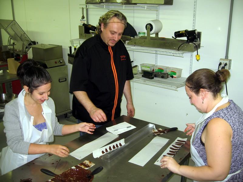 Chef Poulain critiques Alyssa's (l) and Katie's work