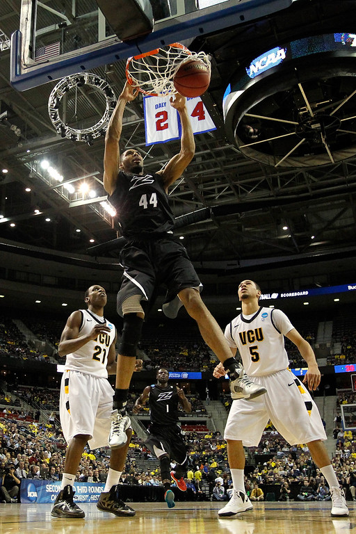 . AUBURN HILLS, MI - MARCH 21:  Zeke Marshall #44 of the Akron Zips dunks in the first half against Treveon Graham #21 and Teddy Okereafor #5 of the Virginia Commonwealth Rams during the second round of the 2013 NCAA Men\'s Basketball Tournament at at The Palace of Auburn Hills on March 21, 2013 in Auburn Hills, Michigan.  (Photo by Gregory Shamus/Getty Images)
