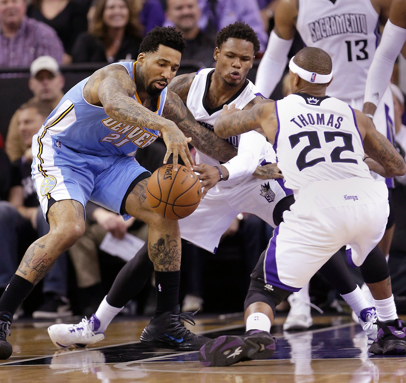 . Denver Nuggets forward Wilson Chandler, left, battles Sacramento Kings\' Ben McLemore, center, and Isaiah Thomas, for the ball during the third quarter of an NBA basketball game in Sacramento, Calif., Sunday, Jan. 26, 2014. The Nuggets won 125-117.(AP Photo/Rich Pedroncelli)