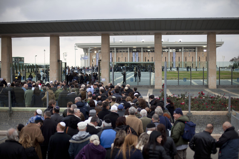 . Israelis stand in line to pay their last respect to Ariel Sharon outside the Knesset (Israeli Parliament), where his body is lying in state on January 12, 2014 in Jerusalem, Israel.(Photo by Lior Mizrahi/Getty Images)