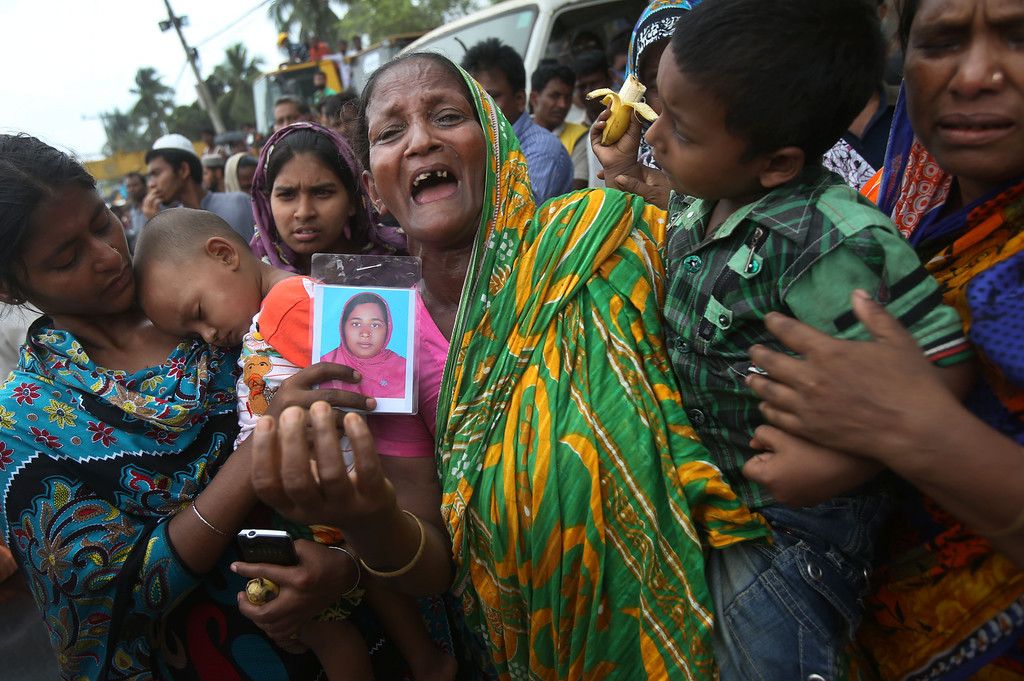 . A woman grieves for her daughter-in-law who was trapped in the collapsed garment factory building on Tuesday 30, April, 2013 in Savar, near Dhaka, Bangladesh.  (AP Photo/Wong Maye-E)