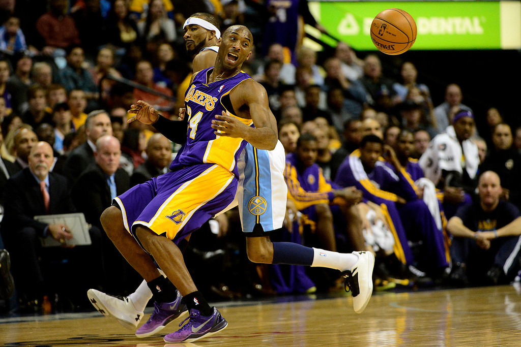 . Los Angeles Lakers shooting guard Kobe Bryant (24) loses the ball after Denver Nuggets small forward Corey Brewer (13) poked it away during the first half at the Pepsi Center on Wednesday, December 26, 2012. AAron Ontiveroz, The Denver Post