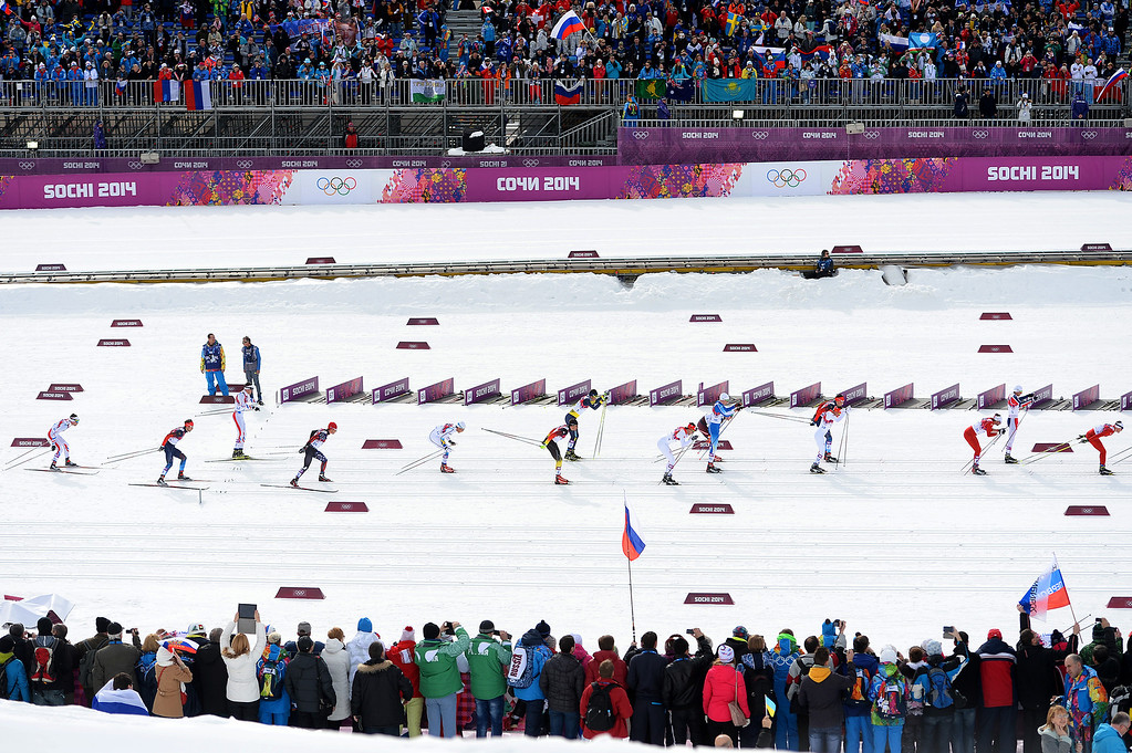 . SOCHI, RUSSIA - FEBRUARY 09:  Skiers compete in the Men\'s Skiathlon 15 km Classic + 15 km Free during day two of the Sochi 2014 Winter Olympics at Laura Cross-country Ski & Biathlon Center on February 9, 2014 in Sochi, Russia.  (Photo by Harry How/Getty Images)