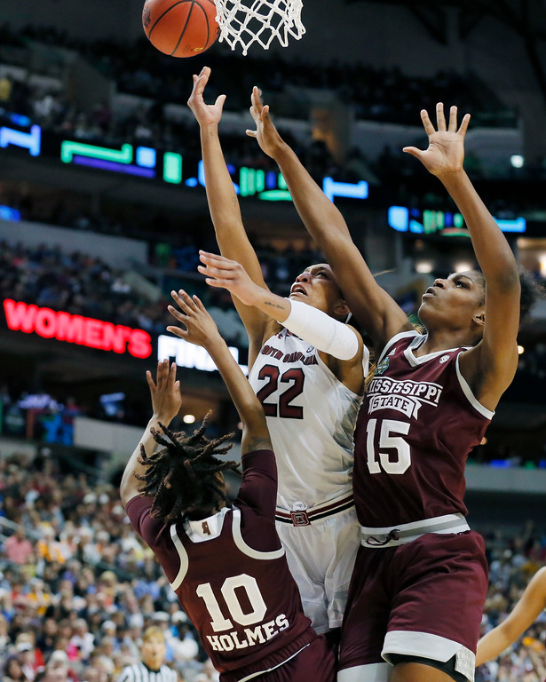 . South Carolina forward A\'ja Wilson (22) drives to the basket between Mississippi State guard Jazzmun Holmes (10) and center Teaira McCowan (15) during the final of NCAA women\'s Final Four college basketball tournament, Sunday, April 2, 2017, in Dallas. (AP Photo/Tony Gutierrez)