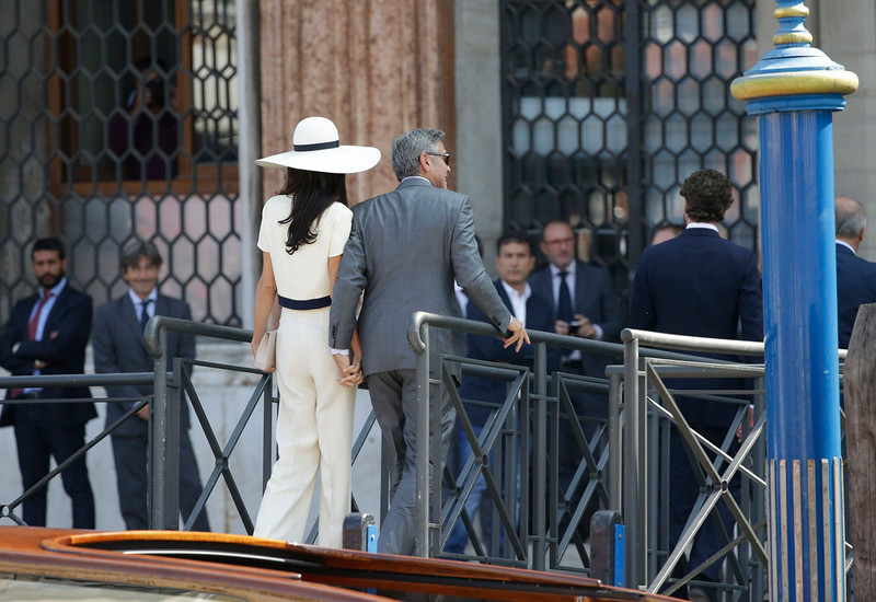 . George Clooney and Amal Alamuddin arrive at Venice\'s city hall, Italy, Monday, Sept. 29, 2014. Clooney and Amal married Saturday, Sept. 27, the actor\'s representative said, out of sight of pursuing paparazzi and adoring crowds.(AP Photo/Andrew Medichini)
