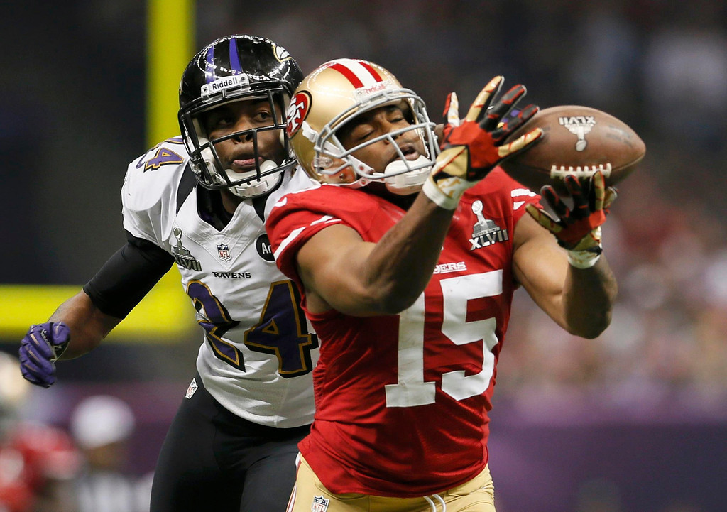 . San Francisco 49ers wide receiver Michael Crabtree (15) is unable to hang onto a pass against Baltimore Ravens cornerback Corey Graham (24) in the third quarter in the NFL Super Bowl XLVII football game in New Orleans, Louisiana, February 3, 2013. REUTERS/Lucy Nicholson