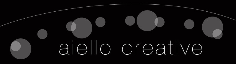 aiello creative logo_bw reverse.jpg