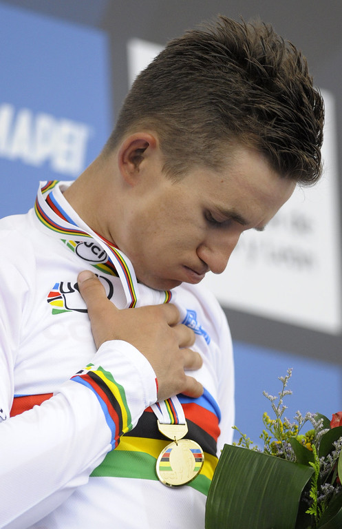 . Poland\'s Michal Kwiatkowski celebrates on the podium after winning the men\'s road race at the 2014 UCI Road World Championships in Ponferrada on September 28, 2014.  MIGUEL RIOPA/AFP/Getty Images