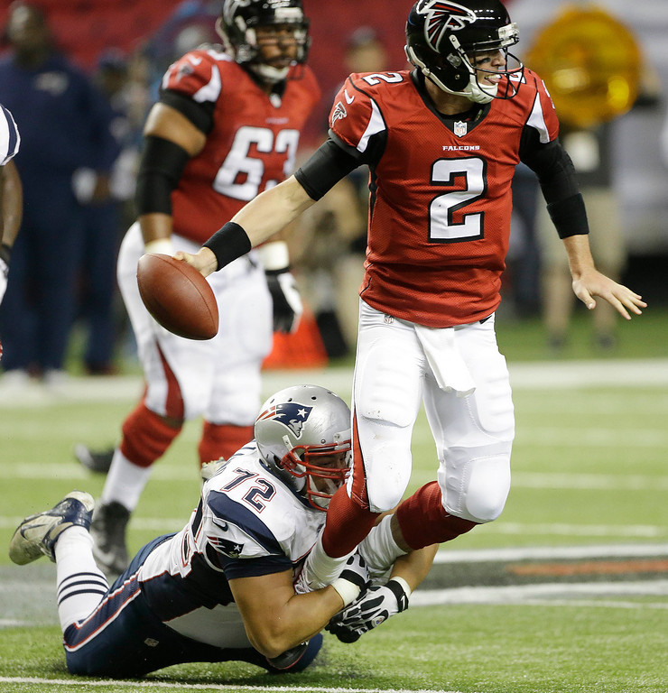 . Atlanta Falcons quarterback Matt Ryan (2) is sacked by New England Patriots defensive tackle Joe Vellano (72) during the second half of an NFL football game, Sunday, Sept. 29, 2013, in Atlanta. (AP Photo/John Bazemore)
