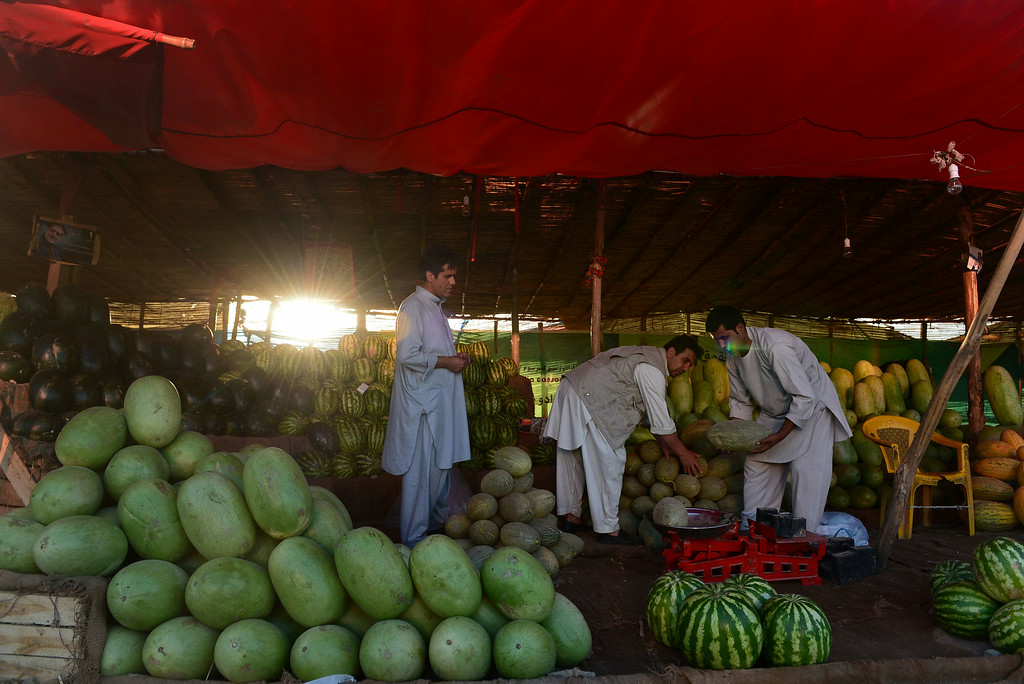 . Afghan residents buy watermelons from a roadside stall near a market ahead of the Islamic holy month of Ramadan in Kabul on June 28, 2014. Muslims are preparing for Islam\'s holy month of Ramadan, which is calculated on the sighting of the new moon, and during which they fast from dawn until dusk. WAKIL KOHSAR/AFP/Getty Images