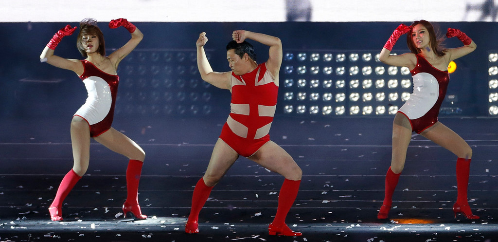 """. South Korean rapper Psy performs during his concert \""""Happening\"""" in Seoul April 13, 2013. Psy performed his new song \""""Gentleman\"""" in public for the first time on Saturday at the concert at Seoul\'s World Cup stadium.  REUTERS/Lee Jae-Won"""