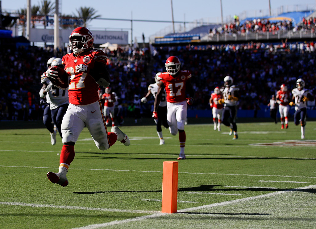 . Kansas City Chiefs running back Kareem Hunt, left, scores against the Los Angeles Chargers during the second half of an NFL football game, Sunday, Sept. 24, 2017, in Carson, Calif. (AP Photo/Jae C. Hong)