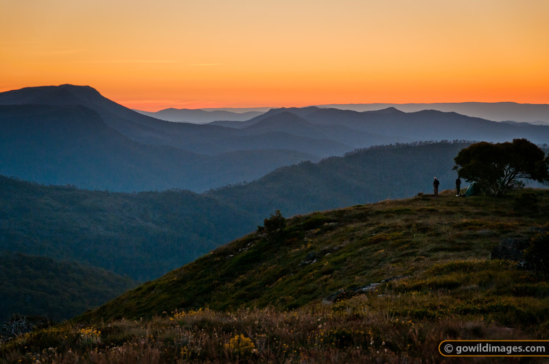 Campers enjoy a sunset view of King Valley from Mt Speculation