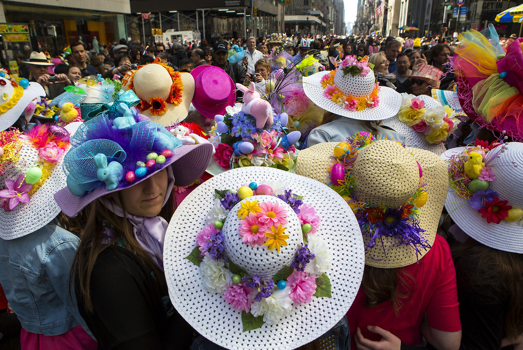 . NEW YORK - APRIL 20:  People wear bonnets during the Easter Parade and Bonnet Festival along 5th Avenue in New York. The parade is a New York tradition dating back to the mid-1800s when the social elite would parade their new fashions down Fifth Avenue after attending Easter services in one of the Fifth Avenue churches.  (Photo by Eric Thayer/Getty Images)