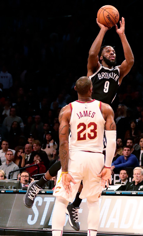. Brooklyn Nets\' DeMarre Carroll (9) shoots over Cleveland Cavaliers\' LeBron James (23) during the second half of an NBA basketball game Wednesday, Oct. 25, 2017, in New York. The Nets won 112-107. (AP Photo/Frank Franklin II)