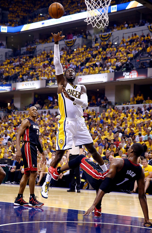 . INDIANAPOLIS, IN - MAY 28:  Roy Hibbert #55 of the Indiana Pacers goes up for a shot as Chris Bosh #1 of the Miami Heat defends during Game Five of the Eastern Conference Finals of the 2014 NBA Playoffs at Bankers Life Fieldhouse on May 28, 2014 in Indianapolis, Indiana.  (Photo by Andy Lyons/Getty Images)